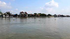 Chao Phraya River in Pakkret. Pakkret, Nonthaburi, Thailand - April 19, 2018: Thailand`s main river Chao Phraya River in Pakkret on April 19, 2018 in Nonthaburi stock footage