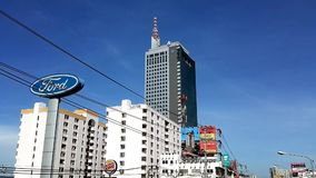 View of Chaengwattana Road in Pakkret. PAKKRET, NONTHABURI, THAILAND - JUNE 2, 2018: View of Jasmine Tower other buildings and traffic on a Saturday morning on stock video