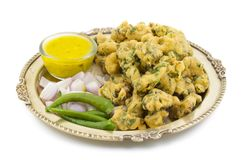 Pakora or Bhajiya. Bhajiya or Pakora is made with gram flour and spinach, This is the favorite street food of Indian and Pakistani people stock photos