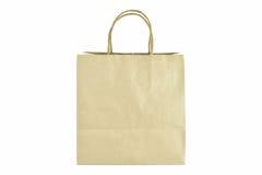 Pakpapier het winkelen zak met handvatten over op witte achtergrond Stock Foto