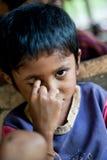 PAKSE, LAOS, el 14 de agosto: Un Laos no identificado poco en el hous Fotografía de archivo libre de regalías