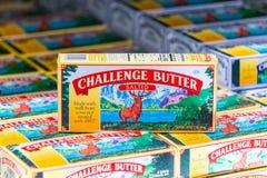 Pakunki wyzwanie oznakują solonego masło dla sprzedaży obraz stock