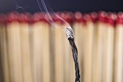 palący matchstick fotografia stock