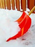 Pala anaranjada de la nieve Imagen de archivo libre de regalías