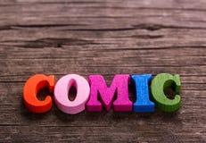 Palabra cómica hecha de letras de madera imagen de archivo libre de regalías