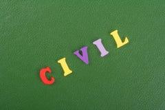 Palabra CIVIL en el fondo verde compuesto de letras de madera del ABC del bloque colorido del alfabeto, espacio de la copia para  Imagen de archivo