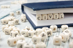 Palabra CIVIL escrita en el bloque de madera ABC de madera Fotografía de archivo libre de regalías