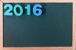 Palabra colorida 2016 en el tablero negro como fondo Fotos de archivo libres de regalías