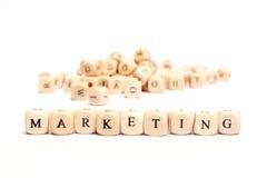 Palabra con el márketing de los dados Fotografía de archivo libre de regalías