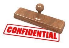 Palabra confidencial en sello de madera Fotos de archivo libres de regalías