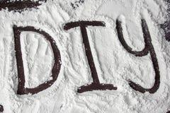 Palabra de DIY pintada en la harina stock de ilustración