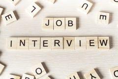 Palabra de Job Interview escrita en el bloque de madera ABC de madera Fotografía de archivo libre de regalías