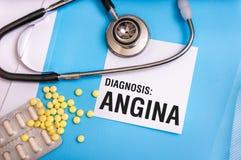 Palabra de la angina escrita en carpeta azul médica con los ficheros pacientes fotografía de archivo libre de regalías