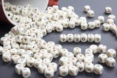 Palabra de la blanco escrita en el bloque de madera ABC de madera Imagen de archivo libre de regalías