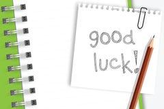 Palabra de la buena suerte en el papel de nota Fotos de archivo libres de regalías