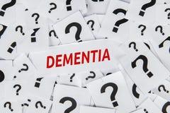 Palabra de la demencia con los signos de interrogación imagen de archivo
