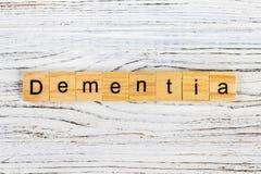Palabra de la demencia hecha con concepto de madera de los bloques fotografía de archivo