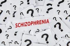 Palabra de la esquizofrenia con símbolo del signo de interrogación imagenes de archivo