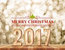 Palabra de la Feliz Navidad 2017 en sitio de la perspectiva con sparklin del oro Imágenes de archivo libres de regalías