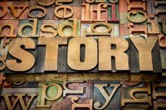 Palabra de la historia en el tipo de madera fotografía de archivo