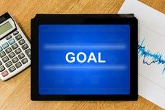 Palabra de la meta en la tableta digital Imagen de archivo libre de regalías