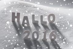 Palabra de la Navidad blanca hola 2016 medios hola en la nieve, copos de nieve Foto de archivo libre de regalías