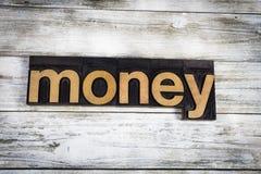 Palabra de la prensa de copiar del dinero en fondo de madera Foto de archivo libre de regalías