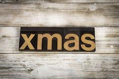 Palabra de la prensa de copiar de Navidad en fondo de madera Imagen de archivo