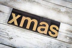 Palabra de la prensa de copiar de Navidad en fondo de madera Fotos de archivo libres de regalías