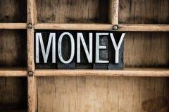 Palabra de la prensa de copiar del metal del concepto del dinero en cajón Foto de archivo libre de regalías