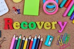 Palabra de la recuperación en corcho foto de archivo
