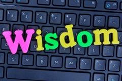 Palabra de la sabiduría en el teclado de ordenador Imagen de archivo libre de regalías