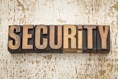 Palabra de la seguridad en el tipo de madera Imagen de archivo libre de regalías