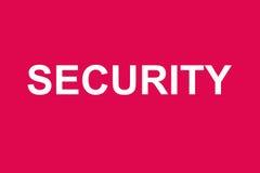 Palabra de la seguridad en fondo rojo fotos de archivo