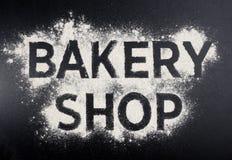 Palabra de la tienda de la panadería hecha de la harina Logotipo de la tienda que cuece Fotografía de archivo libre de regalías