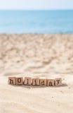 Palabra de las vacaciones y fondo soleado de la playa Fotografía de archivo libre de regalías
