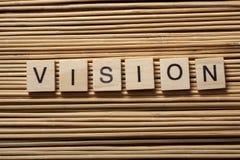Palabra de VISION en los cubos de madera del ABC en el fondo de madera Imagenes de archivo