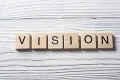 Palabra de VISION en los cubos de madera del ABC en el fondo de madera Fotos de archivo