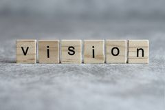 Palabra de Vision escrita en el cubo de madera imagen de archivo