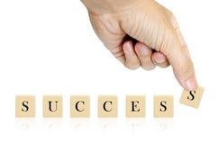 Palabra del éxito de la mano y de la palabra Fotografía de archivo libre de regalías