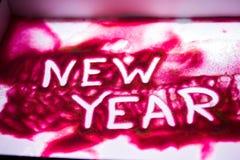 Palabra del ` del Año Nuevo del ` en la arena rosada Imagen de archivo