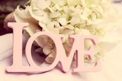 Palabra del amor como detalle de la boda Imagenes de archivo