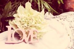 Palabra del amor como detalle de la boda Imagen de archivo libre de regalías