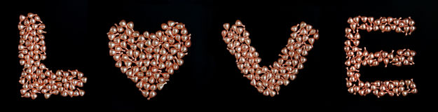 Palabra del amor con la perla Imágenes de archivo libres de regalías