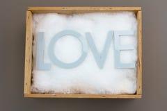 Palabra del amor en la caja Fotografía de archivo libre de regalías