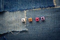 Palabra del amor en vaqueros Foto de archivo libre de regalías