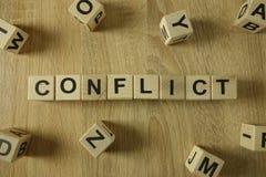 Palabra del conflicto de bloques de madera fotografía de archivo libre de regalías