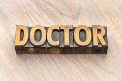 Palabra del doctor en el tipo de madera fotografía de archivo