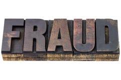 Palabra del fraude en el tipo de madera Fotografía de archivo libre de regalías