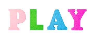 Palabra del juego con las letras de madera Imagen de archivo libre de regalías